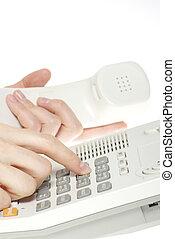 phone keypad - finger with  white telephone keypad