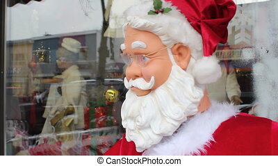 Dancing robot Santa Head closeup - Robotic santa dancing...