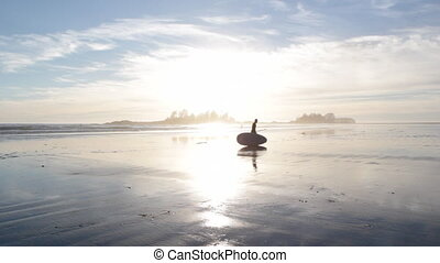 Paddleboarder at sunset - Silhouette of man with paddleboard...