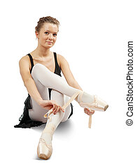 ballerina puts on pointe. Isolated over white background