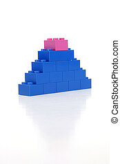 Climbing Upward - Pink block on top of a blue tower...