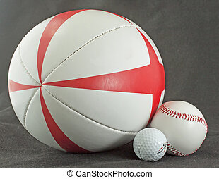 Rugby, golf and baseball - Three different balls for rugby,...