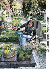 disabled woman in a wheelchair - A woman is Gehbenidert...