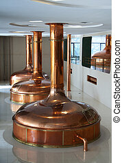 three brewing vessels in brewery - Shining copper tuns used...