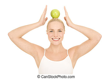 woman with green apple on the head