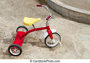 Abandoned Tricycle - Abandoned red tricycle with a yellow...