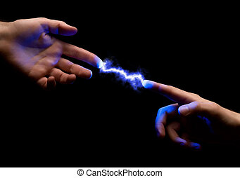 spark between hands - blue powerful electric spark between...