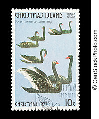 seven swans swimming - Part of a set of 12 mail stamp...