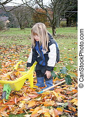 Laubsammler Leaf collector - a blond girl in the garden work...