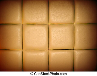 Tan Leather Upholstry Background with a Repetitive pattern...