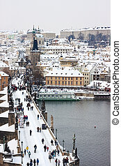 Winter in Prague looking over the Charles Bridge to the...