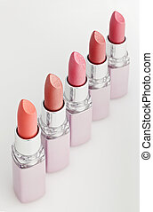 Color lipsticks arranged in line isolated on white