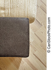 Details of leather sofa headboard on Wooden floor