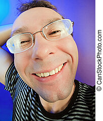 Funny happy man in glasses portrait on vivid color background