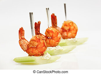 Tiger shrimp canape with celery isolated on white