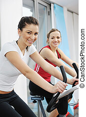 woman workout in fitness club on running track - young woman...