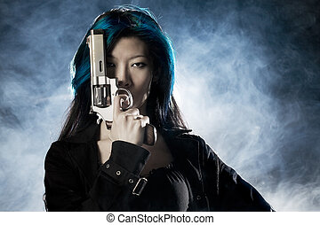 Asian beauty holding gun with smoke
