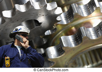 machinist and gear machinery - engineer and giant gear...