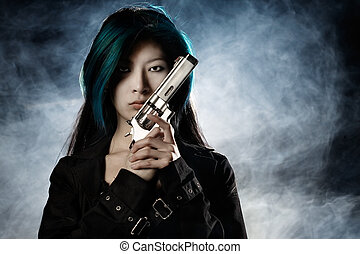 Femme Fatale - Asian beauty holding gun with smoke in...
