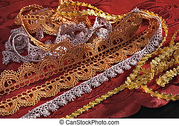 Laces for clothes furnish on a red background