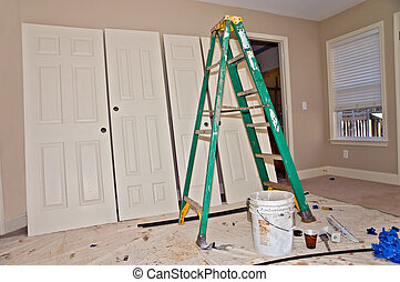 Home Remodeling - Painters tools and equipment in a room...