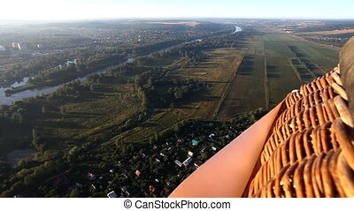 View on plain landscape and river from hot air balloon