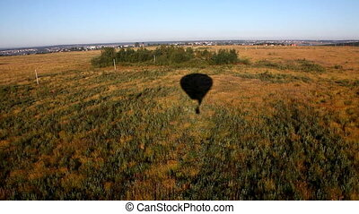 view from flying hot air balloon on shadow
