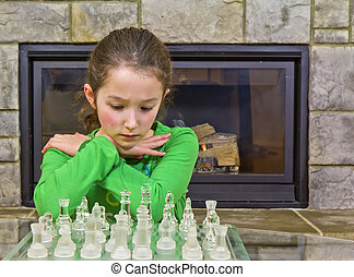 Chess Player- Decision Time - Young girl making some quick...
