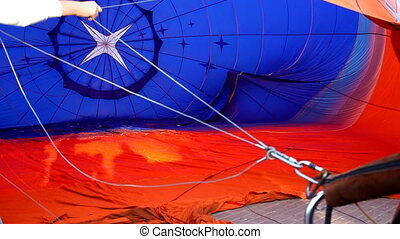 Hot air balloon on ground and fire from jet