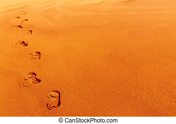 Footprints on sand dune, desert concept