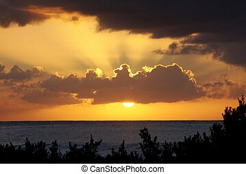 Ocean Sunset - Rays Behind Cloud at Ocean Sunset with...