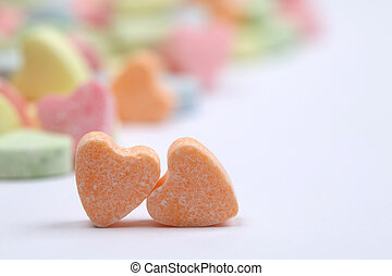 Candy hearts - Little colorful candy hearts on white...