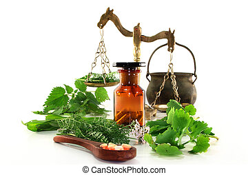 Naturopathy - fresh herbs and spices on a white background
