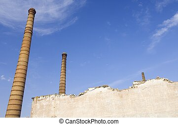 smokestacks and blue sky with clouds