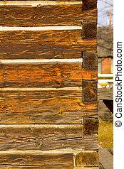 Portrait photo of antique square log construction - Portrait...