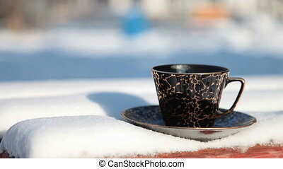 cup of hot coffee in winter