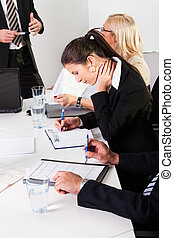 Businesswomen taking notes at the presentation - Young...