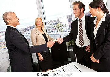 Business people exchange business cards after the meeting