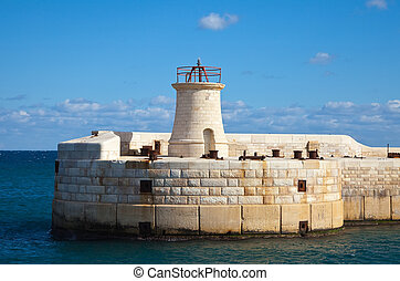 lighthouse at entrance in Grand Harbour (Valletta, Malta)