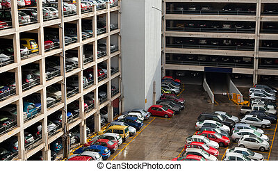 multilevel parking place with many cars in European city