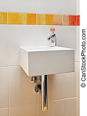 Modern wash stand with unusual faucet