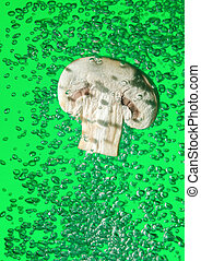 Field mushroom falling in water with air bubbles - Field...