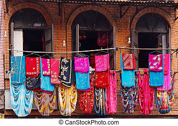 Storefront of old nepal textile shop with many multicolored...