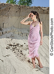 Lady in a pink scaly sundress on sand quarry - Beautiful...