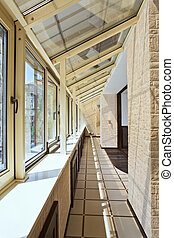 Long balcony gallery interior with pvc windows