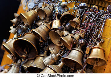 Many metal sacrificial bells hanging on chain, Kathmandu,...