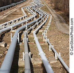 Pipelines leading into the horizon with power-station - View...