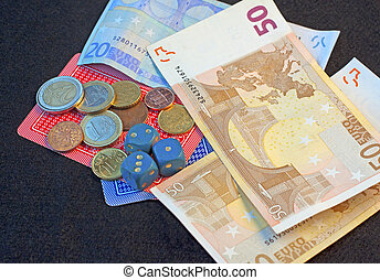 Game - Dice, playing cards, some banknotes and money over...