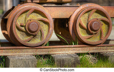 Old rail car wheels - High dynamic range image of small gold...