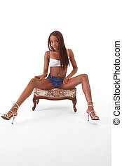 Young sexy ethnic black African-American woman in denim...